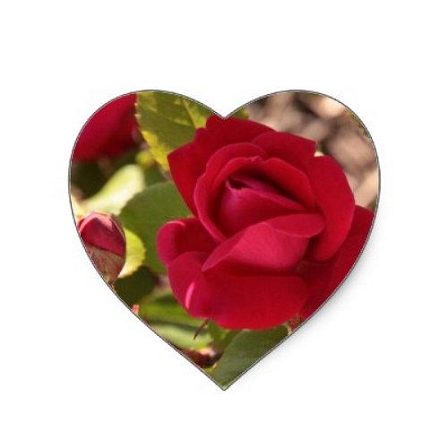 Un corazon, adentro se ve una rosa